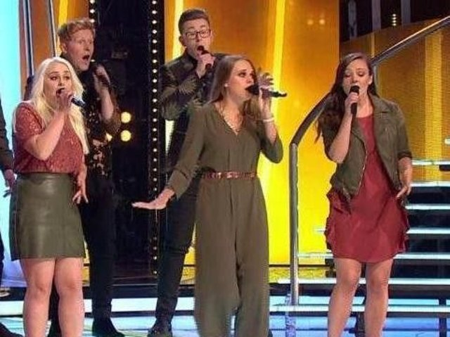 Hit single -Talented young singer Becky Bowe, centre, pictured as part of Leeds Contemporary Singers on BBC TV's Pitch Battle.