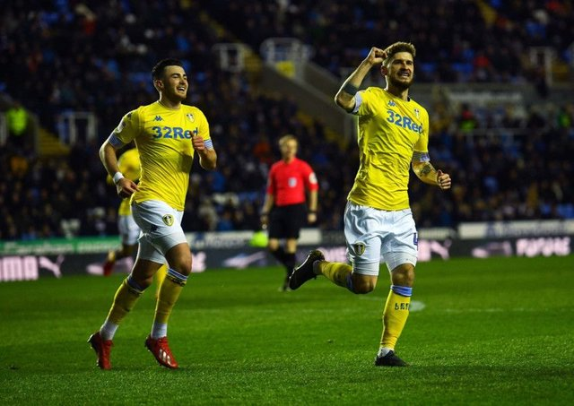 Mateusz Klich leaves Jack Harrison in his wake as he celebrates after scoring Leeds Uniteds opening goal in their comfortable 3-0 victory away to Reading on Tuesday (Picture: Jonathan Gawthorpe).