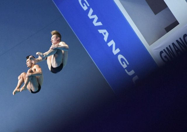 In sync: Jack Laugher and Dan Goodfellow en route to winning their silver medals. (Pictures: MANAN VATSYAYANA/AFP/Getty Images)
