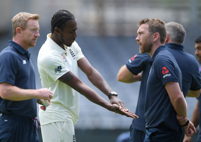 BAD SIGN: England bowler Jofra Archer chats with physio Craig de Weymarn at Newlands in Cape Town. Picture: Stu Forster/Getty Images