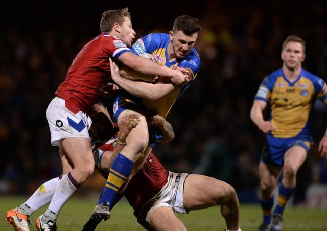 AIMING HIGH: Jordan Baldwinson is held by Wakefield's Kyle Wood and Tinirau Arona at Headingley last Friday.  Picture Bruce Rollinson