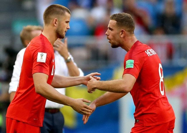 England's Eric Dier (left) is substituted on for England's Jordan Henderson (right) during the FIFA World Cup quarter-final with Sweden (Picture: PA)