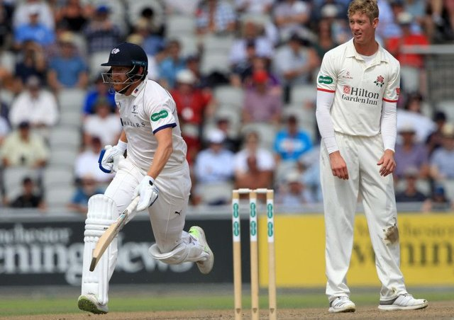 LEADING MAN: Yorkshire's Jonny Bairstow runs a single to reach his half century as Lancashire's Keaton Jennings looks on. Picture:Clint Hughes/Getty Images.