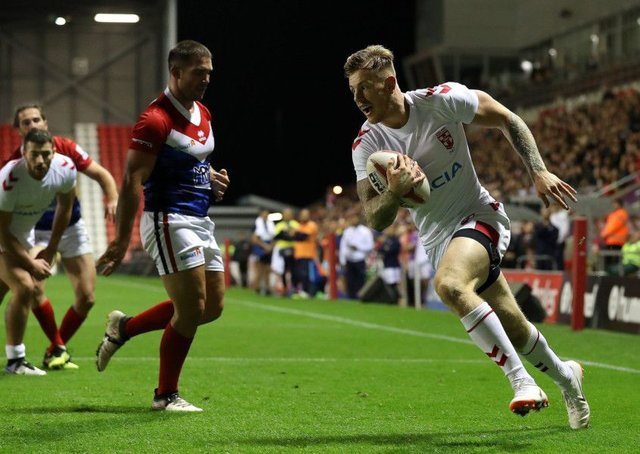 Crossing: England's Tom Johnstone goes over for a try against France.