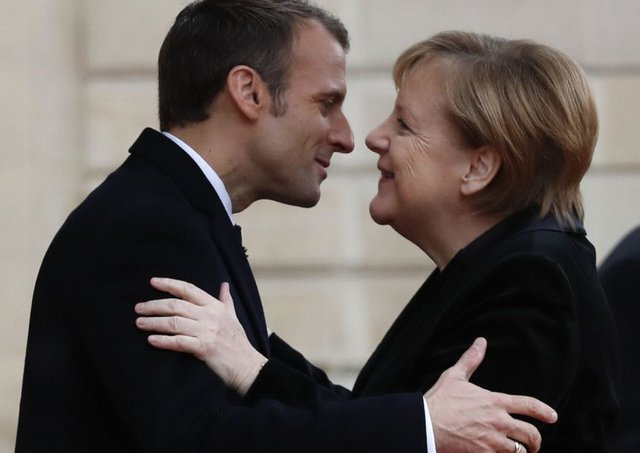 French President Emmanuel Macron hugs German Chancellor Angela Merkel in Paris last weekend ahead of a ceremony to mark the 100th anniversary of the end of the Great War. (AP).
