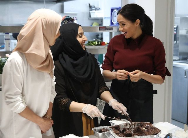 The Duchess of Sussex during her to visit the Hubb Community Kitchen, London, to see how the funds raised by Together: Our Community Cookbook are making a difference.