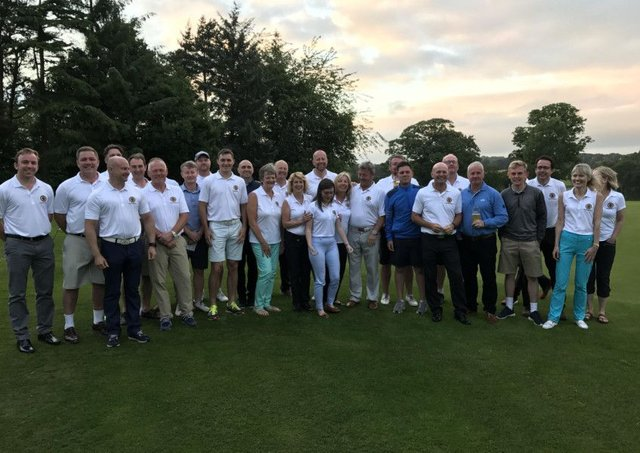 Players gather for a group photograph ahead of Headingleys marathon golfing day, which saw 25 players play five rounds.