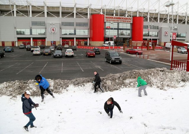 Children enjoy the snow outside Middlesbrough's Riverside Stadium before the Sky Bet Championship match between Middlesbrough and Leeds.
