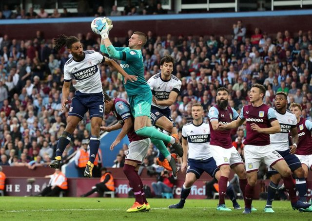 Aston Villa goalkeeper Sam Johnstone jumps to claim the ball ahead of Middlesbroughs Ryan Shotton during last nights Championship semi-final play-off second leg at Villa Park (Picture: Martin Rickett/PA Wire)