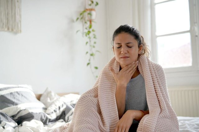 A cough, muscle pain, fatigue and a sore throat could be more common in those who test positive for the new UK variant of Covid (Photo: Shutterstock)