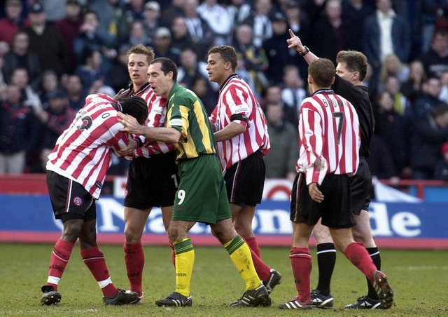Referee Eddie Wolstenholme (far right) took charge of the Battle of Bramall Lane.
