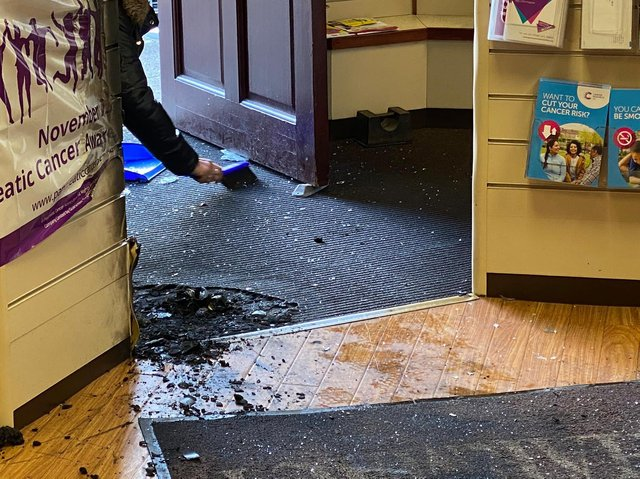 The damage to the pharmacy following the attack