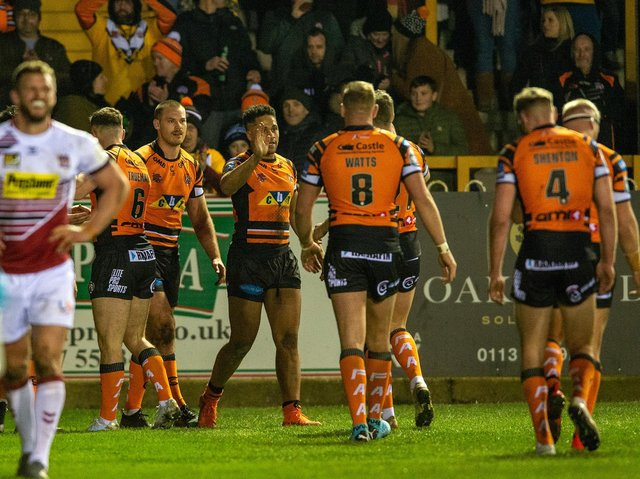 Tigers celebrate Derrell Olpherts' first try for the club, against Wigan. Picture by Bruce Rollinson.
