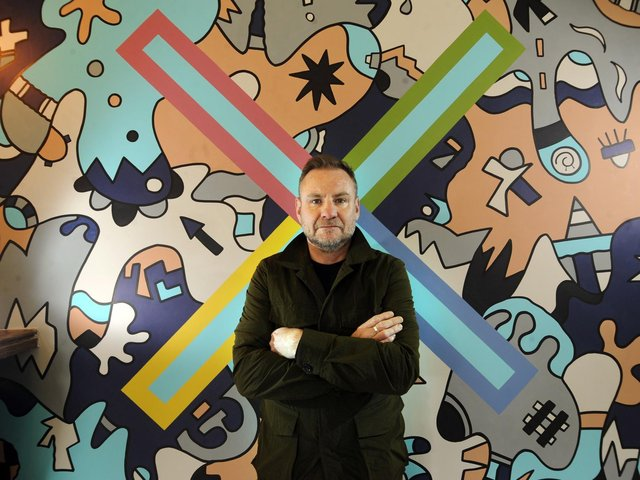 Nicolas Dixon with his mural at the Foundry Restaurant, Leeds. Picture by Simon Hulme
