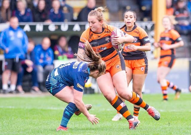Castleford's Rhiannon Marshall evades the tackle of Wigan's Amanda Sibbald.