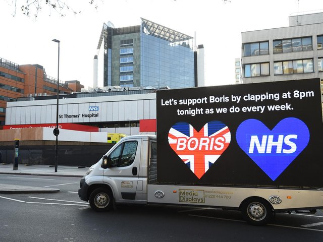 A billboard van outside St Thomas' Hospital in Central London where Prime Minister Boris Johnson is undergoing treatment. Photo: PA