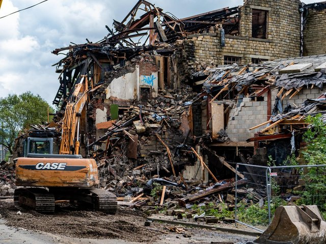 The start of the demolition work at the old Walkleys Clogs Mill, on Burnley Road, Mytholmroyd, after a fire ripped through the build in August 2019.  Picture James Hardisty.