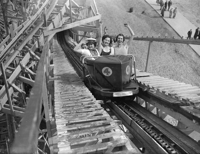 May 1936:  Holidaymakers on a fairground ride at Butlin's in Skegness.  (Photo by Fox Photos/Getty Images)