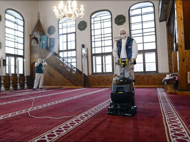 Workers disinfect the Cobanija mosque in Sarajevo, Bosnia. Disinfection began in mosques in the Bosnian capital Sarajevo and throughout the country, in order to limit the spread of the COVID-19 infections, ahead of holy month of Ramadan.(AP Photo/Kemal Softic)