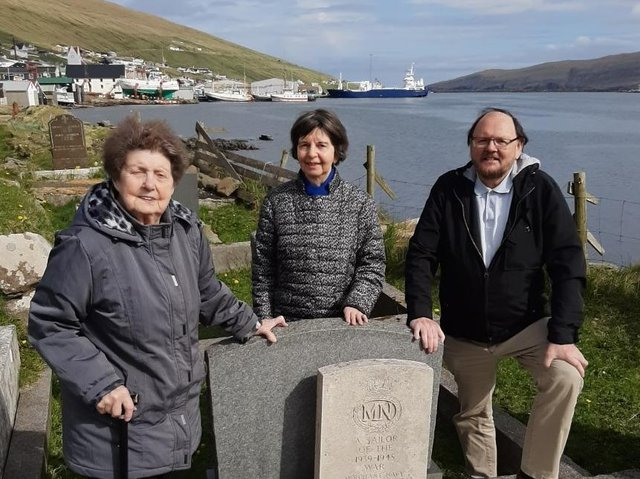 Tina Tausen and other Faroes islanders by the grave