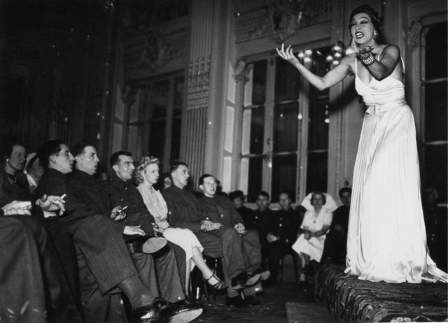 Josephine Baker performs for troops at the British Leave Club at the Hotel Moderne in Paris, May 1940. (Photo by Fox Photos/Hulton Archive/Getty Images)