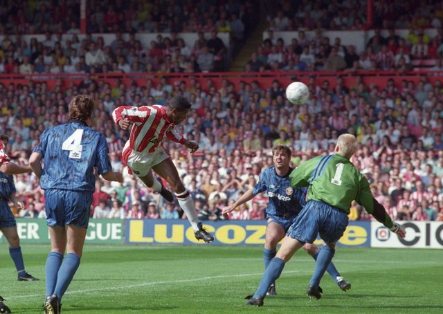 On target: Sheffield United striker Brian Deane scores the first goal in Premiership history, against Manchester United in August, 1992.