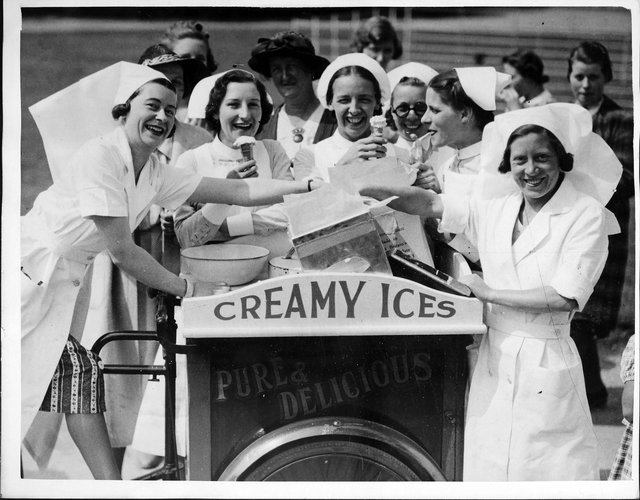 Nurses commandeer the ice-cream man and his 'creamy ices' as soon as he arrives at the Radcliffe Infirmary Fete in Oxford, with his bicycle cart, England.  (Photo by J. R. V. Johnson/Fox Photos/Hulton Archive/Getty Images)