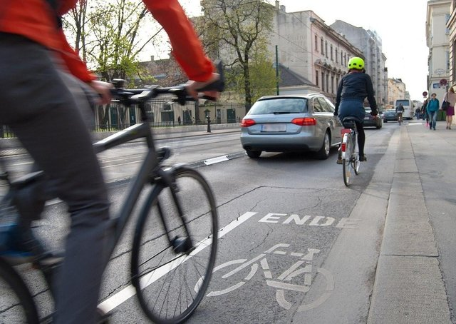 How can the road safety risks to cyclists be reduced?
