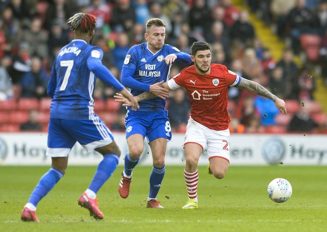 Barnsley's Alex Mowatt comes under pressure from Cardiff's Joe Ralls and Leandro Bacuna at Oakwell on March 7 - the last time Gerhard Struber's team played. Picture: Dean Atkins.