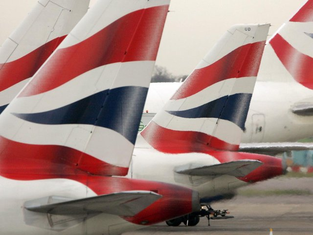 """File photo of tail fins of British Airways' aircraft parked at Terminal One of London's Heathrow Airport. British Airways' treatment of its workforce during the coronavirus pandemic """"is a national disgrace"""", MPs claimed. Photo: PA"""