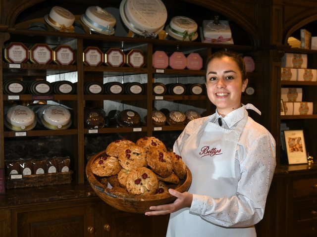 Eve Pike, assistant retail manager at Bettys in the Harrogate shop which is reopening on Monday, with a basket of fat rascals. Picture: Gary Longbottom.