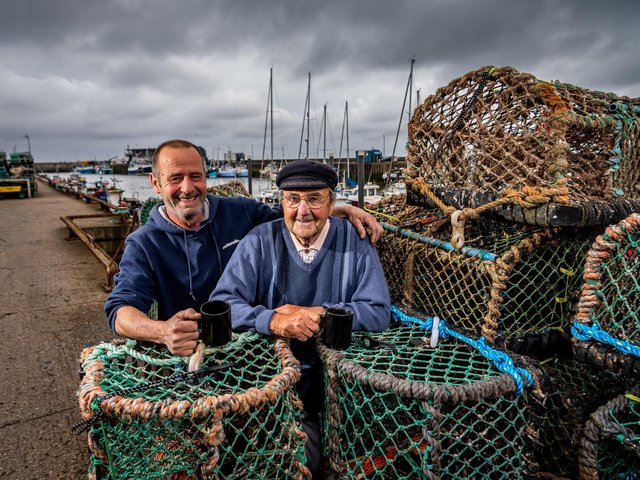 Rolly Rollisson, 91, with son Rolo, 58, by their lobster pots in Bridlington Harbour Picture: James Hardisty