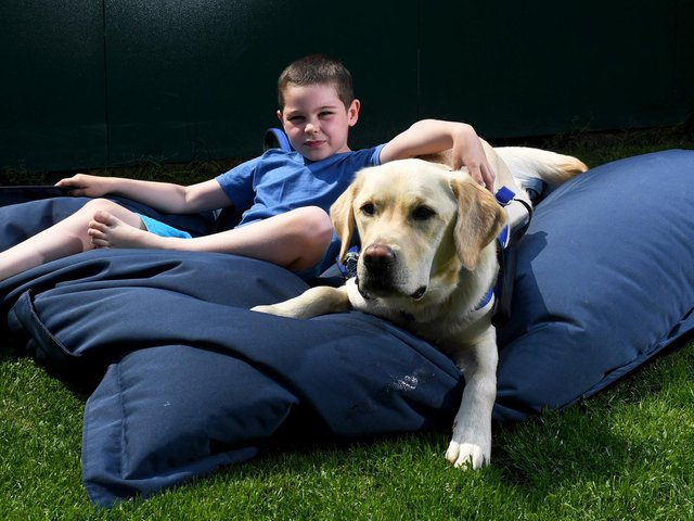 Thomas with his Support Dog Marky. Picture by Simon Hulme