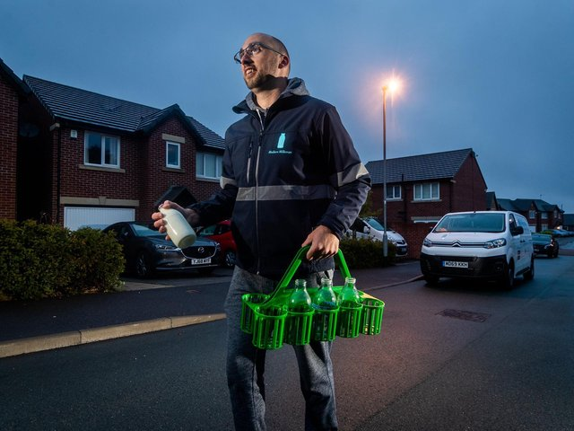 Milkman Andy Walker, aged 33, on his rounds in Pudsey, Leeds, delivering milk and Veg boxes for the Modern Milkman. Picture: James Hardisty