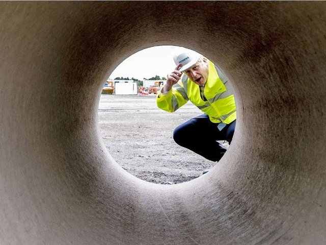Prime Minister Boris Johnson looks through a large bore pipe during a visit to the Siemens Rail factory construction site in Goole. Picture: Peter Byrne/PA Wire