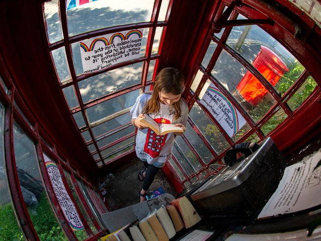 Martha Kennerley, 10, in the phone box in St Hildas Road, Harrogate. The Oatlands Community Group has submitted a planning app to formally adopt for 1 25 June 2020. Picture Bruce Rollinson