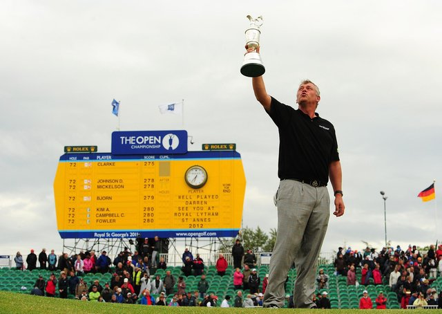File photo dated 17/07/2011 of Darren Clarke holding the Claret Jug after winning the 2011 Open Championship during round four of the 2011 Open Championship at Royal St George's, Sandwich. PRESS ASSOCIATION Photo. Issue date: Saturday July 30, 2011. The PGA Championship will start on August 11th, at Atlanta Athletic Club, Georgia, USA. See PA Story GOLF USPGA. Photo credit should read: Owen Humphreys/PA Wire. Use subject to restrictions. Editorial use only. No commercial use. Call +44 (0)1158 447447 for further information