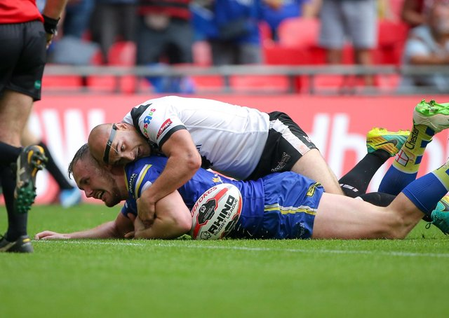 Top challenge: Hull FC's Danny Houghton's match-saving tackle on Warrington's Ben Currie. Picture: SWPIX