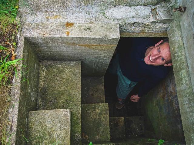 James Fox in the air raid shelter found in his garden in York