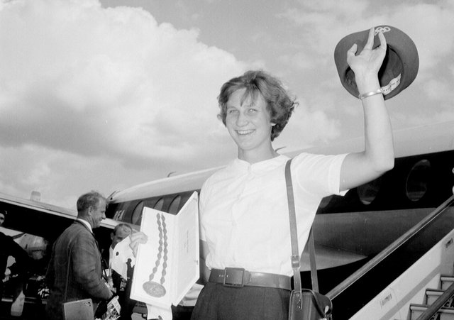 Anita Lonsbroigh return to Britain in triumph following her gold medal success at the 1960 Rome Olympics.