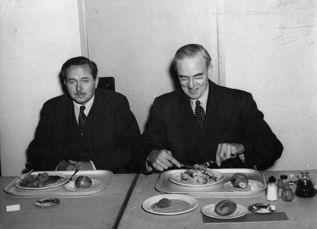 British Labour politician Harold Wilson, newly appointed President of the Board of Trade, with Sir Stafford Cripps, former President of the Board of Trade, newly appointed Minister for Economic Affairs, at the opening of the staff canteen at the Board of Trade.  Original Publication: People Disc - HL0252   (Photo by Edward G Malindine/Getty Images)
