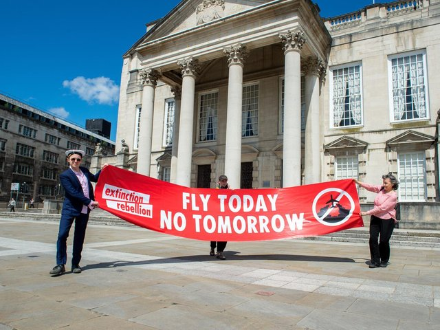 Christopher Hore, Alstair Chestermn and Drew Long of Extinction Rebellion hold socially distanced protest against expansion of Leeds Bradford Airport outside Leeds Civic Hall. 21 May 2020. Picture: Bruce Rollinson