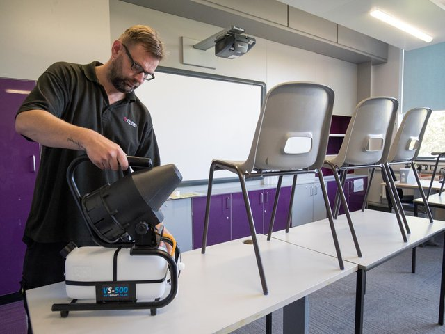 A fogging machine, which can disinfect a whole classroom, is set up in a classroom at Ark Charter Academy in Portsmouth, as preparations are made before the start of the new term.