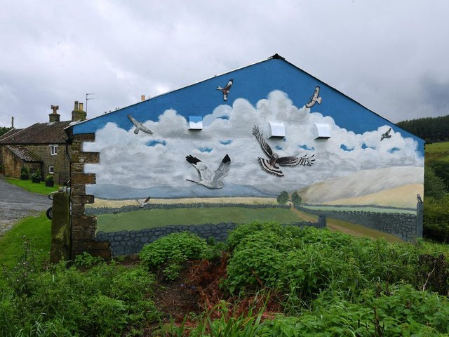 The mural pointedly overlooks a grouse moor