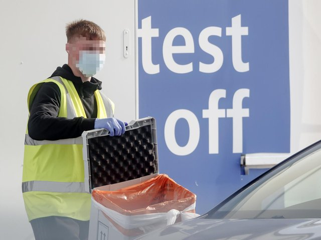 A worker at a Covid-19 driving in testing centre at Temple Green Park and Ride in Leeds, West Yorkshire. Photo: PA