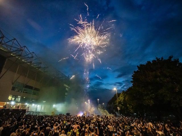 Leeds United fans celebrate the team's promotion to the Premier League