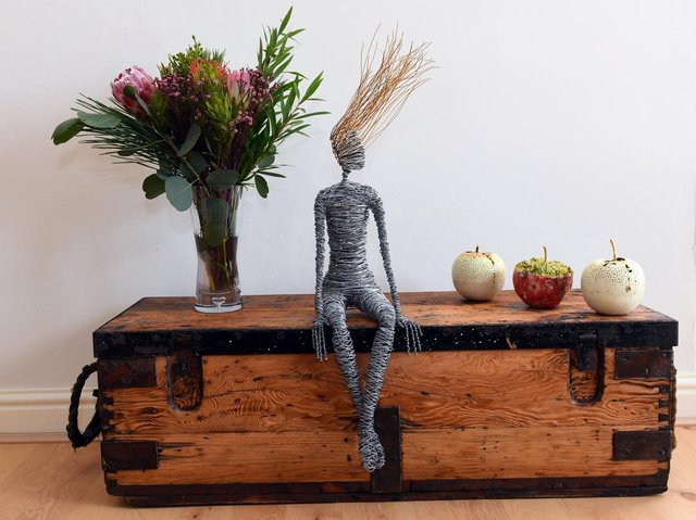 One of Nick's wooden chests with a wire sculpture by Rachel Ducker and ceramic apples by Remon Jephcott.