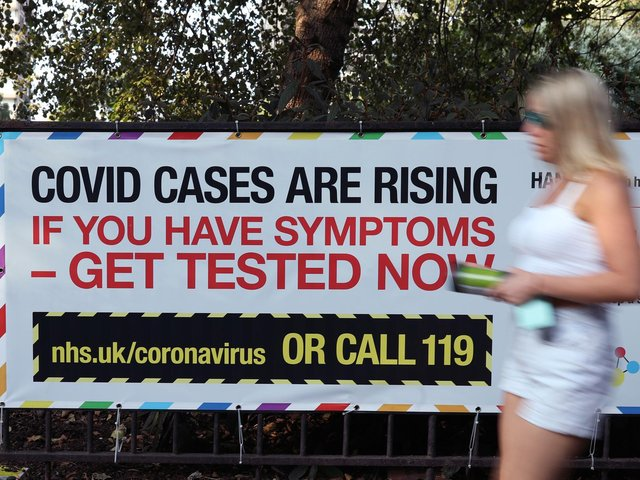 A public information sign warning of rising Covid-19 cases in London after Prime Minister Boris Johnson announced a range of new restrictions to combat the the coronavirus outbreak in England. Photo: PA