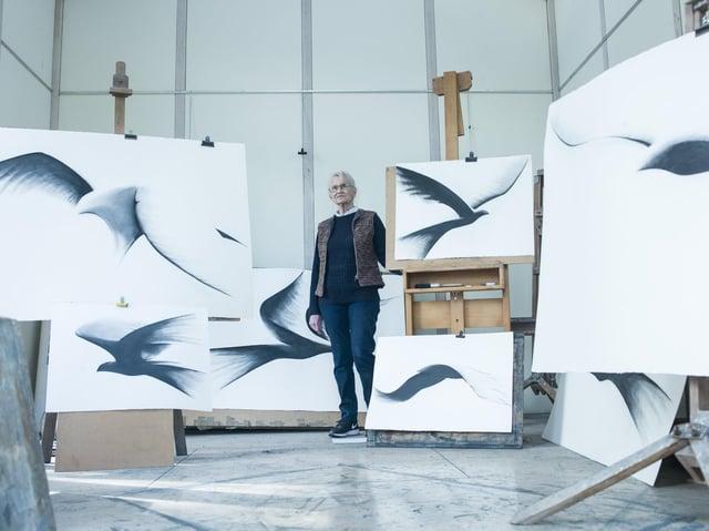 Sculptor Bridget McCrum with studies of birds in flight. (Picture credit: Steve Russell Studios Ltd).