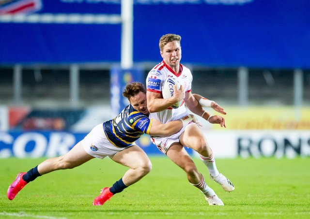 STICKING AROUND: Hull KR's Matt Parcell is tackled by Leeds's James Donaldson. Picture by Allan McKenzie/SWpix.com